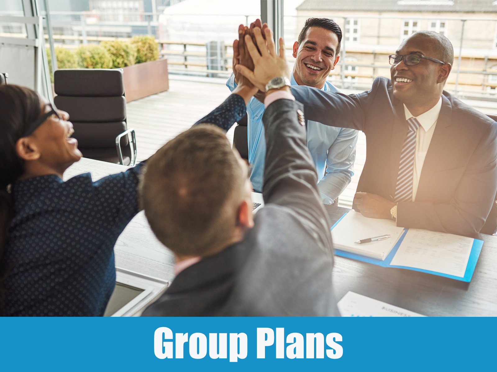 Group Plan image showing a team of young business professionals in an office setting.