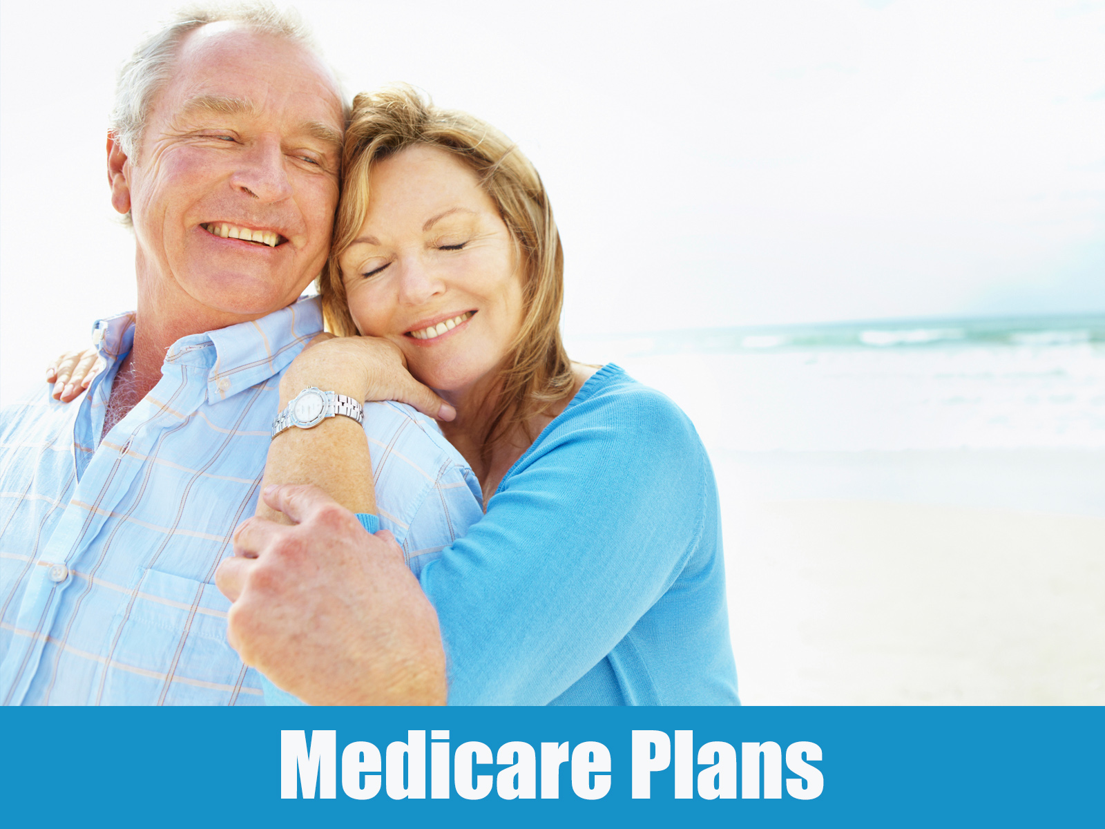 Medicare Plan image showing a senior couple embracing on the beach