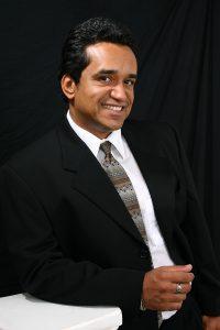 Headshot of Agent Aurelio de Moraes